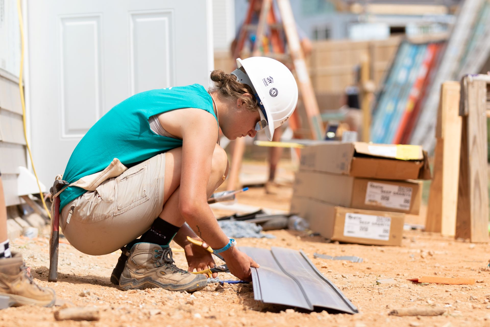 Woman preparing siding for house
